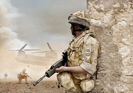 british soldier on standby as the chinook brings supples. Image shot 2009. Exact date unknown.